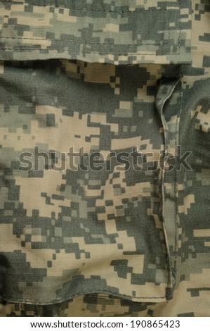 Universal camouflage pattern cargo storage pocket army combat uniform digital camo USA military ACU macro closeup rip-stop fabric texture background foliage green desert sand tan urban grey vertical - stock photo