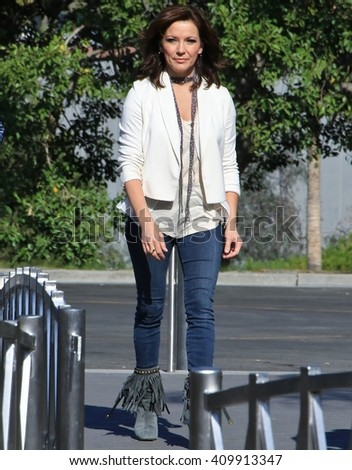 UNIVERSAL CITY CA - APRIL 22, 2016: Country pop singer Martina McBride comes to the set of  entertainment news program 'Extra' for interview with Charissa Thompson April 22, 2016 Universal City CA. - stock photo