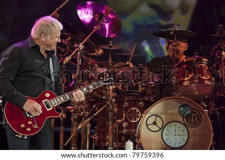 UNIVERSAL CITY, CA - JUNE 22: Alex Lifeson & Neil Peart of the rock band Rush hits the stage for part of their Time Machine Tour at the Gibson Amphitheater in Universal City, CA on June 22, 2011. - stock photo