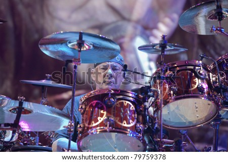 UNIVERSAL CITY, CA - JUNE 22: Neil Peart of the rock band Rush hits the stage for part of their Time Machine Tour at the Gibson Amphitheater in Universal City, CA on June 22, 2011. - stock photo
