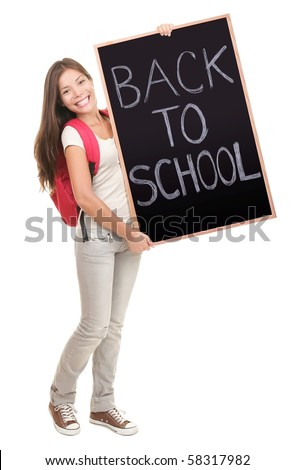 University college student showing blackboard / chalkboard saying back to school. Beautiful mixed race Asian Caucasian young female model. Isolated in full length on white background. - stock photo