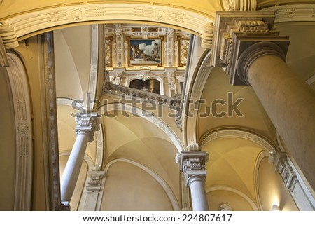 University of Genoa, Italy - School of Humanities.  The school premise is a beautiful antique palace of  '600 with a monumental staircase and painted ceiling. - stock photo