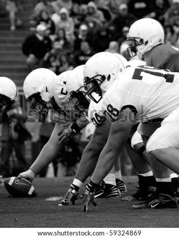 UNIVERSITY PARK, PA - APRIL 24: Penn State linemen get set during a game at Beaver Stadium April 24, 2010 in University Park, PA - stock photo