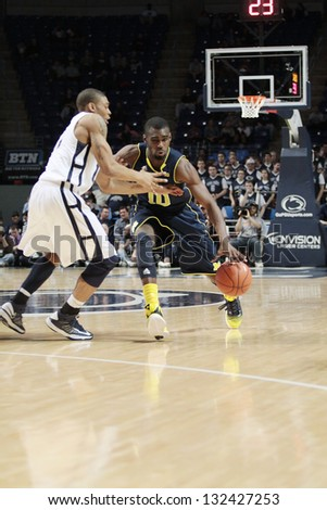 UNIVERSITY PARK, PA -  FEBRUARY 27: Michigan's #10 Tim Hardaway Jr. drives to the basket against Penn State n at the Byrce Jordan Center February 27, 2013 in University Park, PA - stock photo