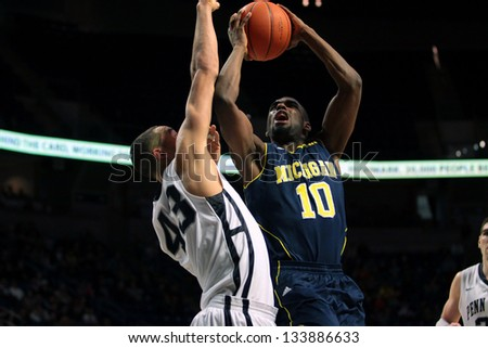 UNIVERSITY PARK, PA - FEBRUARY 27: Michigan's Tim Hardaway Jr. drives to the basket against Penn State at the Byrce Jordan Center February 27, 2013 in University Park, PA - stock photo