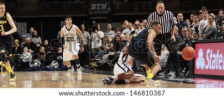 UNIVERSITY PARK, PA - FEBRUARY 27: Michigan's Trey Burke strips Penn State's D.J. Newbill and knocks the basketball out of bounds at the Byrce Jordan Center February 27, 2013 in University Park, PA  - stock photo