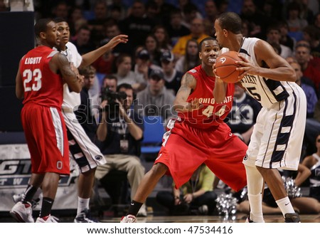 UNIVERSITY PARK, PA - FEBRUARY 24: Penn State's D.J. Jackson looks to pass around #44 William Bufford in a game against Ohio State at the Byrce Jordan Center February 24, 2010 in University Park, PA - stock photo