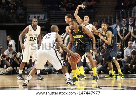 UNIVERSITY PARK, PA - February 27: Penn State's D. J. Newbill is defended by Michigan's Trey Burke at the Byrce Jordan Center February 27, 2013 in University Park, PA - stock photo