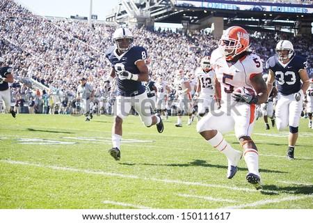 UNIVERSITY PARK, PA - OCT 9: Illinois running back#5 Mikel Leshoure breaks for the sideline against Penn State at Beaver Stadium October 9, 2010 in University Park, PA  - stock photo