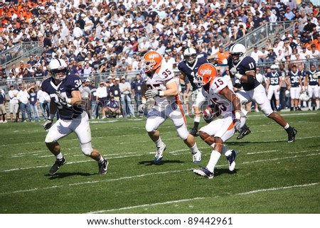 UNIVERSITY PARK, PA - OCT 9: Penn State linebacker Nate Stupar ( No. 34) moves in to make a tackle during loss to Illinois at Beaver Stadium on October 9, 2010 in University Park, PA - stock photo