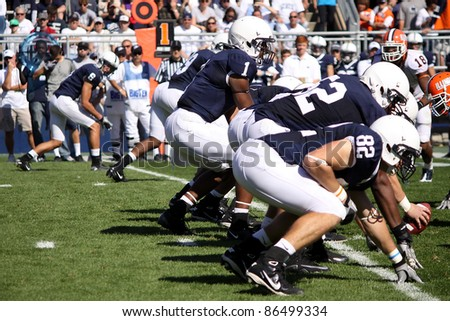 UNIVERSITY PARK, PA - OCT 9: Penn State quarterback Robert Bolden calls the signals at the line of scrimmage during a game with Illinois at Beaver Stadium on October 9, 2010 in University Park, PA - stock photo