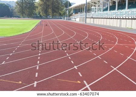 University running track and greem grass. - stock photo