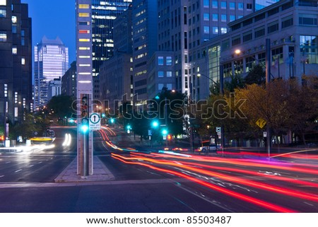 University Street in Montreal with silhouette cars with red rear light and traffic light, early morning to dusk. # 1 - stock photo