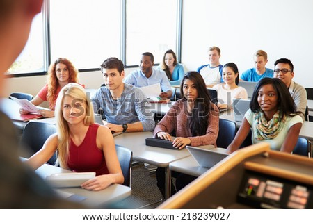 University Students Using Digital Tablet And Laptop In Class - stock photo