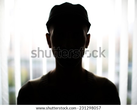 Unknown male person silhouette.Back lit - stock photo