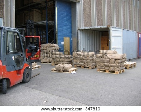 Unloading container outside warehouse - stock photo