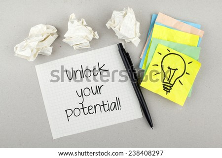 Unlock Your Potential / Motivational Business Quote - stock photo