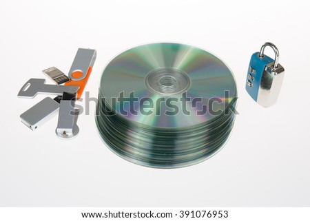 Unlocked open padlock with usb memory stick and CD disk isolated on white background - stock photo