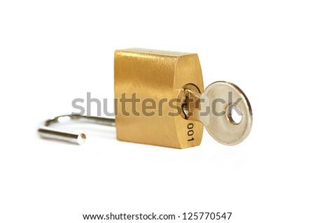Unlocked padlock with the key on white background - stock photo