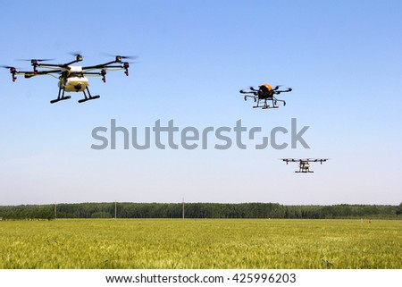 Unmanned aerial vehicle spraying pesticide - stock photo