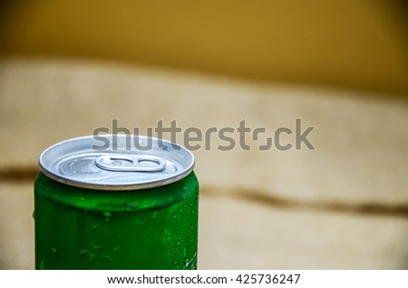 unopened green cold can drink - stock photo