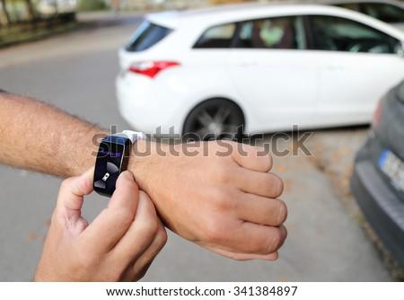 Unparking a autonomous car with a smartwatch - stock photo
