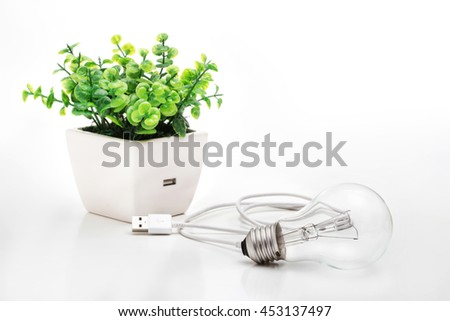 Unplug save the earth.Bulb light unplug from the tree - stock photo
