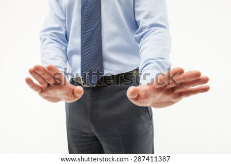 Unrecognizable businessman  demonstrating a gesture of a rejection, white background - stock photo