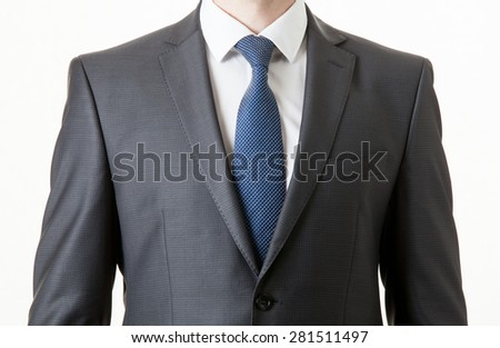 Unrecognizable businessman in a classical suit, white background - stock photo