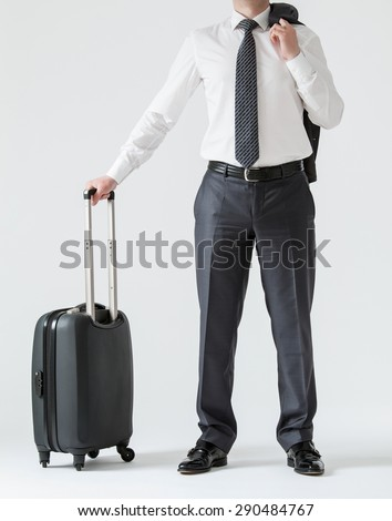 Unrecognizable businessman with a suitcase, white background - stock photo