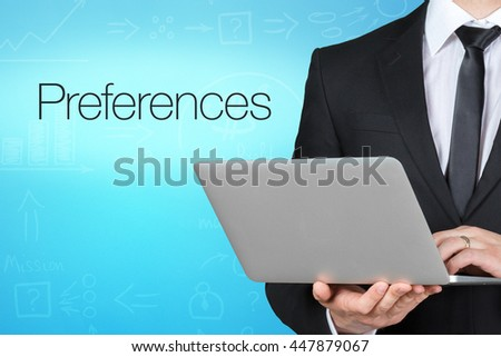 Unrecognizable businessman with laptop standing near text - preferences - stock photo