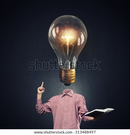 Unrecognizable businessman with light bulb instead of head - stock photo