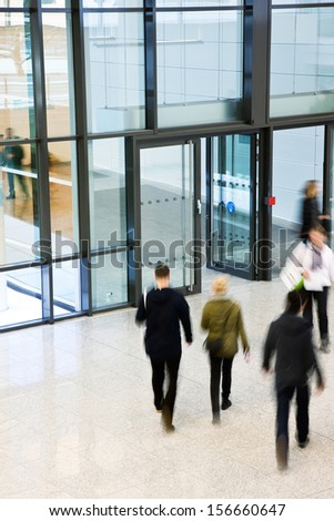 Unrecognizable People Walking in Modern Corridor, Motion Blur - stock photo