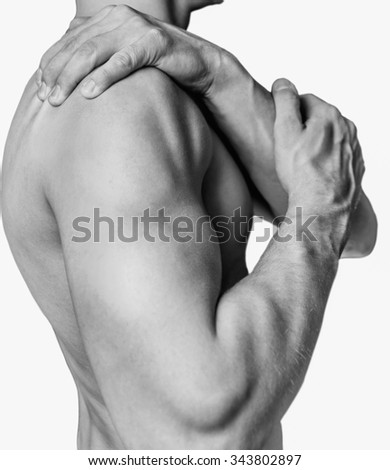 Unrecognizable shirtless man compresses his shoulder, pain in the shoulder. Monochrome image, isolated on a white background - stock photo