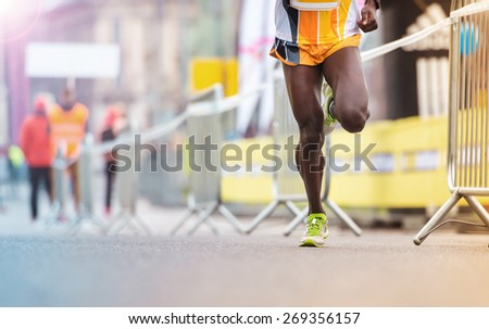 Unrecognizable young runner at the city competition - stock photo