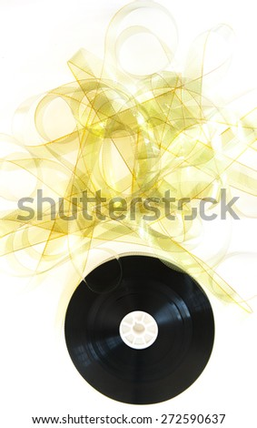 Unrolled 35 mm movie reel with unrolled yellow film strip on white background vertical frame - stock photo