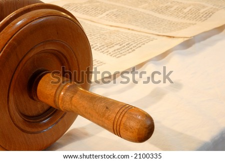 Unrolled Torah scroll - stock photo