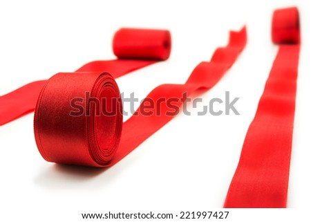 Unrolling red ribbons. Many red ribbons unrolling in multiple directions. isolated on white. - stock photo