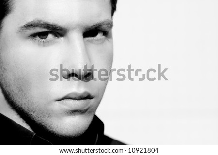 Unshaved handsome man portrait in black and white. Copy space. - stock photo