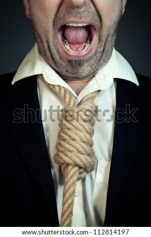 Unshaven businessman with a noose instead of a tie around his neck screaming. - stock photo