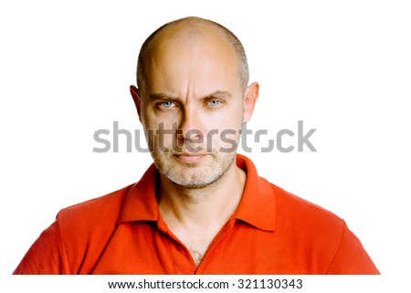 Unshaven fearsome blue eyes middle-aged man in a red T-shirt. Studio. isolated - stock photo