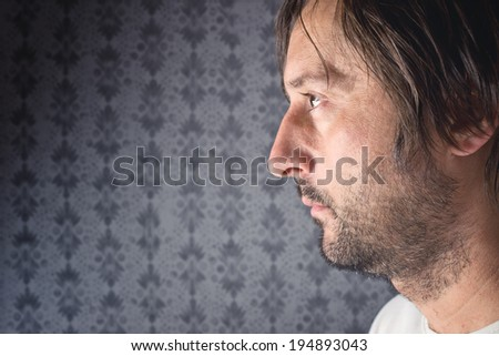 Unshaven man profile portrait with copy space for your text - stock photo