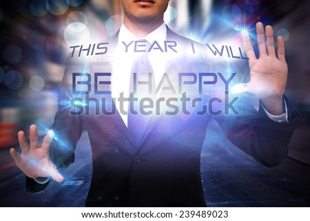 Unsmiling businessman touching against blurry new york street - stock photo