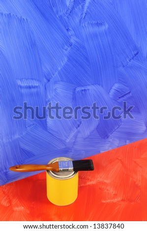 Untidy blank blue painted wall with paint cans and paintbrushes.  Space for copy. - stock photo