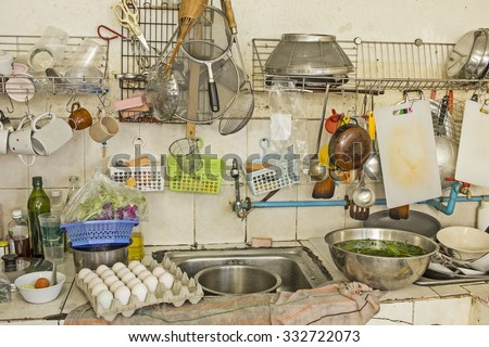 untidy Kitchenware in the kitchen - stock photo