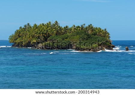 Untouched tropical island with lush vegetation in the Caribbean sea, Bocas del Toro archipelago, Panama - stock photo