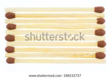 Unused matches in line over white background with reflections  - stock photo
