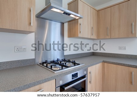 Unused newly fitted kitchen with built-in appliances - stock photo