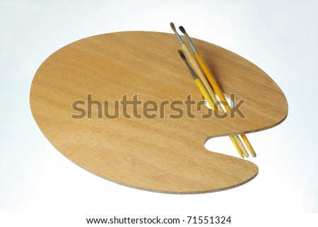Unused painting brushes and palette - stock photo