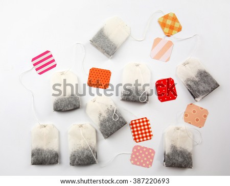 Unused teabags with colourful labels isolated on white background - stock photo